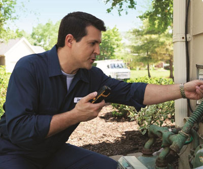 Technician in the field using a mobile device