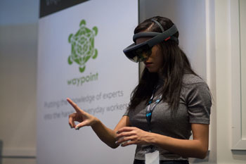 Woman wearing VR goggles and pointing