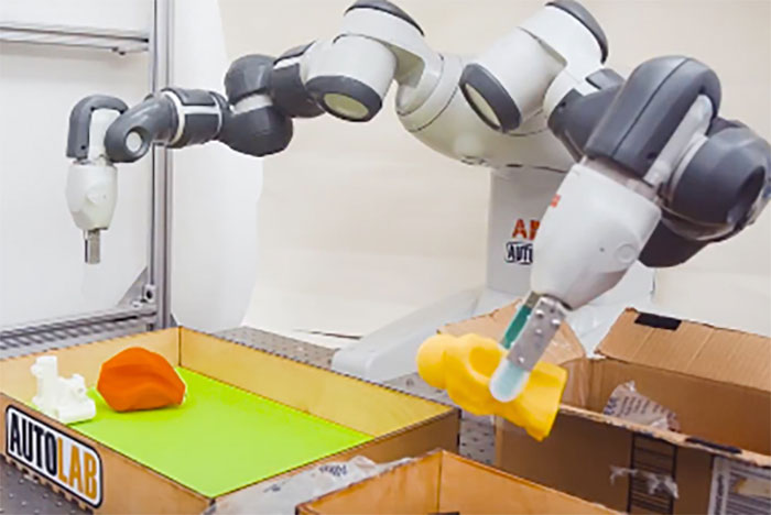 photo of robotic arms using grippers