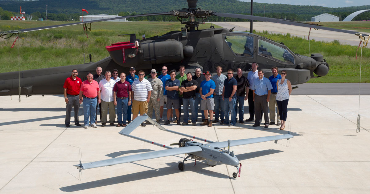 photo of unmanned aerial drone and support team